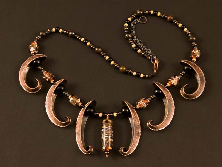 Necklace made with forged copper pieces and lampworked glass beads