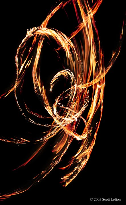 Firedance 1 - Swirls of fire from a long-exposure firespinning shot, photoshopped to increase the color range.