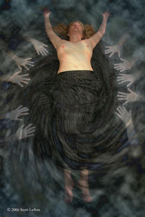 A woman lies floating in swirling mist, a black full-circle skirt spreading around her.  Her chest is bare.  Pale hands reach from the mist towards her and grasp at the skirt.