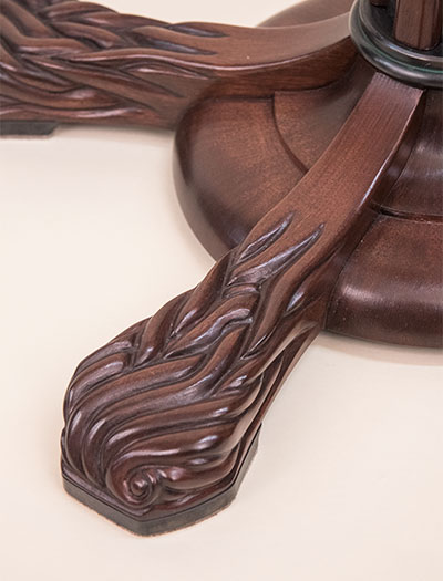 Detail of the Lamp carved mahogany foot.