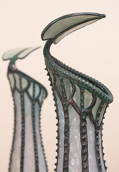 Details of the glass and metal lampshades