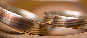 Thumbnail of copper & silver Mokume-gane wedding rings
